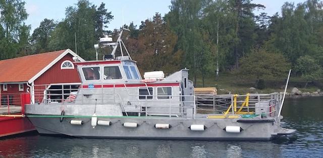 Passagerare och arbetsbåten Folke